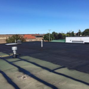 Roofing Application of roofing coating after prep work
